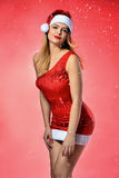 Beautiful model wearing santa`s helper clothes. Royalty Free Stock Images