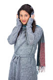 Beautiful model wearing winter clothes listening to music Royalty Free Stock Images
