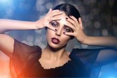 Beautiful model woman in beauty salon makeup Young modern girl i Stock Photo