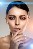 Beautiful model woman in beauty salon makeup Young modern girl i Stock Photos