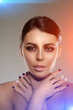 Beautiful model woman in beauty salon makeup Young modern girl i Stock Images