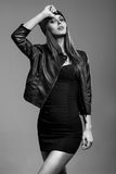 Beautiful model woman in black leather coat and hat Royalty Free Stock Photo