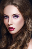 Beautiful Model Woman with Curly Brown Hair and Makeup Royalty Free Stock Photo