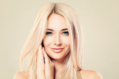 Beautiful Model Woman with Healthy Skin and Blonde Hair. Cute Female Face. Spa Beauty, Facial Treatment and Cosmetology Concept royalty free stock image