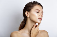 Beautiful model woman with natural make-up and brunette hair stu Royalty Free Stock Images