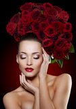 Beautiful model woman rose flower in hair beauty salon makeup Royalty Free Stock Photography