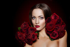 Beautiful model woman rose flower in hair beauty salon makeup Stock Photos