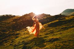 Beautiful woman run in fashion dress on nature royalty free stock images