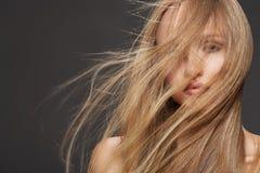 Beautiful model woman shaking head with long hair stock image