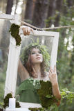 Beautiful model in the woods in a vintage scenery Royalty Free Stock Image