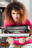 Beautiful model working with abdominal and chest machine Stock Photos