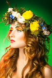 Beautiful model with wreath on green background Stock Photo