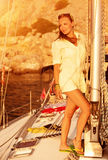 Beautiful model on the yacht on sunset Royalty Free Stock Photography