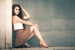 Beautiful model young woman. Fashionable clothes, curly hair. Stock Photos