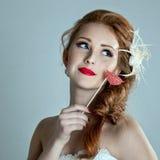 Beautiful modell with a scythe of hair Stock Photos