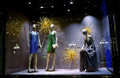 Beautiful models in Gucci fashion boutique exposed for Christmas holidays. Stock Photos