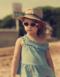 Beautiful moden kid girl in hat and sun glasses Royalty Free Stock Images