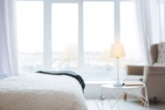 Beautiful modern bedroom located in the city Royalty Free Stock Image