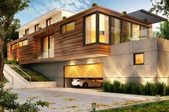 Beautiful modern house with a large garage for cars. Beautiful modern big house with a large garage for cars royalty free stock image