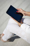 Beautiful modern businesswoman holding tablet Stock Photo