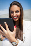 Beautiful modern businesswoman holding tablet Royalty Free Stock Images