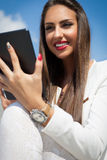 Beautiful modern businesswoman holding tablet computer Royalty Free Stock Photo