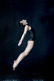 Beautiful modern dancer dancing under water drops Stock Photo