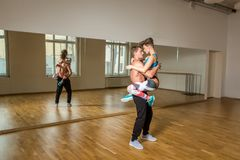 Modern dancers practicing in dance studio. Beautiful modern dancers couple  practicing in dance studio. mirror room. copy space Royalty Free Stock Images