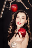 Beautiful Modern Eve luring you with the forbidden fruit Stock Photography