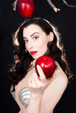 Beautiful Modern Eve luring you with the forbidden fruit Royalty Free Stock Image