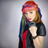 The beautiful modern girl in bright east scarf Stock Image