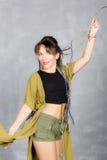 Beautiful modern girl dancing and laughs. Royalty Free Stock Image