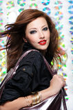 Beautiful modern girl holding shopping bag Stock Photography