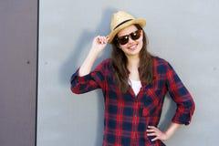 Beautiful modern girl near the wall. Youth style. Fashion shot. Stock Photography
