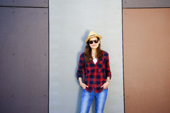 Beautiful modern girl near the wall. Youth style. Fashion shot. Royalty Free Stock Photo