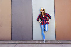 Beautiful modern girl near the wall. Youth style. Fashion shot. Royalty Free Stock Images