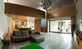 Beautiful modern house in cement, interiors. View from the living room Stock Photography