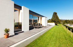 Beautiful modern house. In cement, view from the garden Royalty Free Stock Photos