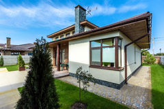 Beautiful modern house in cement, view from the garden Stock Photography