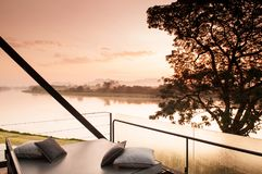 Beautiful modern loft balcony with river view of vacation villa royalty free stock images