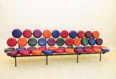 Beautiful and Modern Sofa. Beautiful sofa with small round seats in colorful leather Stock Photo