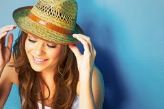 Beautiful modern style woman looking down. Face portrait . yellow hat Royalty Free Stock Photography
