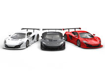 Beautiful modern supercars - red, black and white Royalty Free Stock Photos