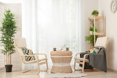 Beautiful modern veranda with cozy armchairs Royalty Free Stock Photo
