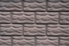 Background of relief bricks lilac stock image