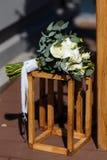 Beautiful modern wedding bouquet lies on a wooden box.  Stock Image