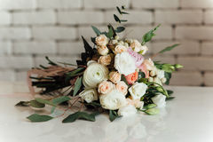 Beautiful modern wedding bouquet on table Royalty Free Stock Images