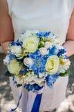 Beautiful modern wedding bouquet on white table stock photos