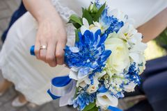 Beautiful modern wedding bouquet on white table stock images