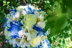 Beautiful modern wedding bouquet on white table royalty free stock photo